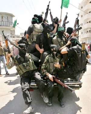 Hamas fighters sit in a vehicle at Preventive Security headquarters after they  captured it in Gaza June 14, 2007. Hamas fighters on Thursday captured one of the last Gaza City bastions of forces loyal to Western-backed Palestinian President Mahmoud Abbas. Green Islamist flags fluttered from the rooftop of the Preventive Security headquarters in Gaza City -- a powerful symbol to residents that Hamas had taken control after five days of bloodshed in which more than 80 people have been killed. REUTERS/Mohammed Salem (GAZA)